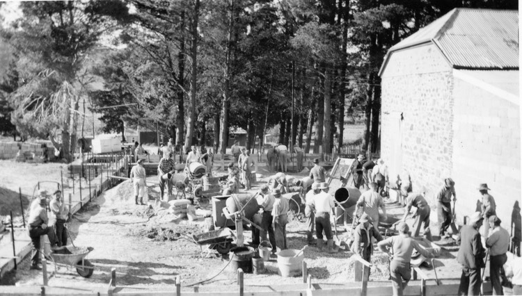 TA265  June 1957 Volunteers laying foundations for new hall